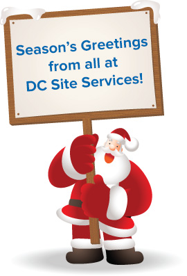 DC Site Services Christmas Santa holding sign