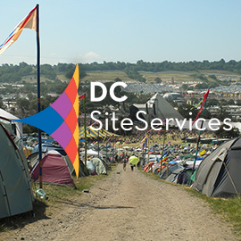 DC Site Services logo over Glastonbury Festival view from the farm