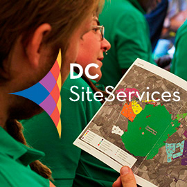 2015 DC Site Services Event Calendar - DC Site Services event staff in a briefing at the Glastonbury Festival