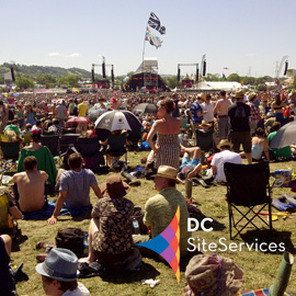 DC Site Services logo over Glastonbury Festival Pyramid Stage photo